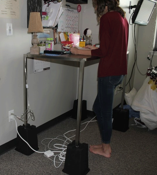 Student standing at desk